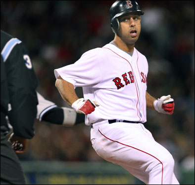 Red Sox shortstop Alex Cora looked to see if he was safe at first base on a seventh-inning bunt single, which moved Willie Harris to second base.