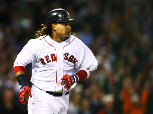 Manny Ramirez rounded the bases after hitting a two-run home run off of Chien-Ming Wang in the third, which put the Sox up 4-1.