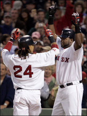 Ramirez (left) and David Ortiz (right) celebrated Ramirez's two-run homer.