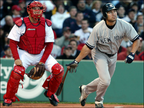 Red Sox catcher Doug Mirabelli and Johnny Damon watched the ball end up in the seats by Pesky Pole for a leadoff home run.