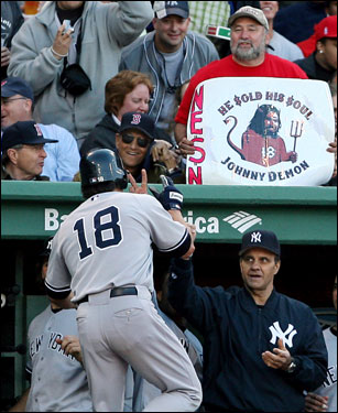 Johnny Damon was congratulated by manager Joe Torre, but not the Fenway faithful, as he entered the dugout after crossing home plate.
