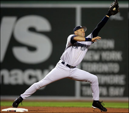 Yankees shortstop Derek Jeter stretched to catch the throw from first baseman Andy Phillips to force Mike Lowell in the fourth inning.