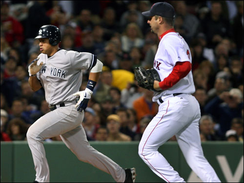 Tim Wakefield ran to cover the plate, but he didn't beat Alex Rodriguez, who scored the fourth Yankees run in the top of the sixth inning.