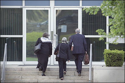 Three unidentified people entered the chancery in Brighton yesterday prior to a meeting of the Caritas Christi hospital board.