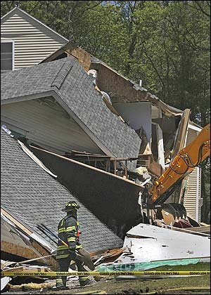A Middleton firefighter surveyed the damage on Thunder Bridge Lane, where an explosion destroyed a house.