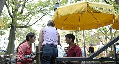 Sarah Brem and Joel Sunshine ordered at the Grendel's Den outdoor patio in Harvard Square this month. Restaurants have applied for permission to serve alcohol on city-owned sidewalks.