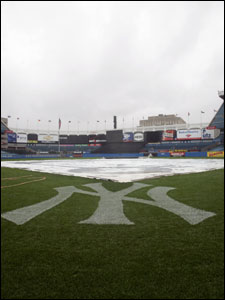 Yankee Stadium was a picture of gray serenity after daylong showers postponed last night's Yankees-Red Sox game.