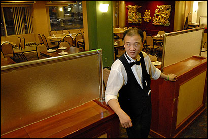 CHAU CHOW CITY, 1:51 A.M. Aaron Mei of Boston waited for customers.