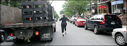 Marilyn Tushman chased a code-enforcement vehicle down Newbury Street yesterday as it hauled away her sidewalk sign.