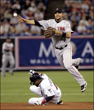 Red Sox shortstop Alex Gonzalez threw to first base after forcing out Minnesota's Luis Castillo during the first inning.
