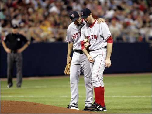Matt Clement was consoled on the mound by teammate Mike Lowell before being taken out of the game during the fifth inning. Clement walked six batters and gave up three runs.