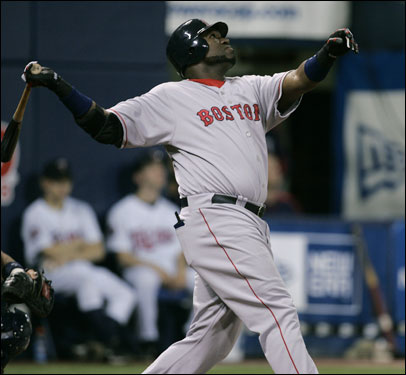 David Ortiz extended his arms on a single against Brad Radke in the first inning.