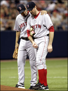 Matt Clement (right) is consoled by third baseman Mike Lowell before he was taken out in the fifth inning.