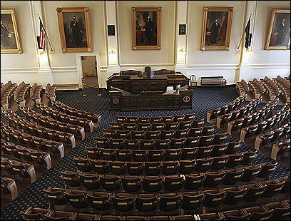 Tour groups see the historic State House gallery in which the House of Representatives meets.