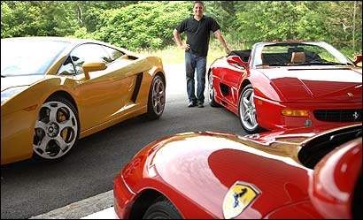 John Caron with (clockwise from left) a Lamborghini Gallardo, a Ferrari F355 Spider F1, and a Ferrari 360 Modena F1.