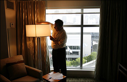 Shawn Black, a manager for Starwood Hotels & Resorts, tested a light last week at the Westin Boston Waterfront Hotel. Black and about 120 other managers have been staying at the hotel to help prepare for its opening.
