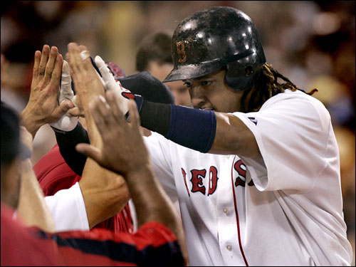 Manny Ramirez was congratulated in the dugout after his solo home run in the eighth inning.