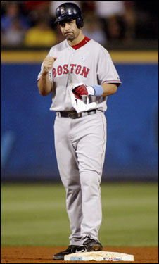 Mike Lowell stood on second base after a double in the eighth inning that scored two runs.