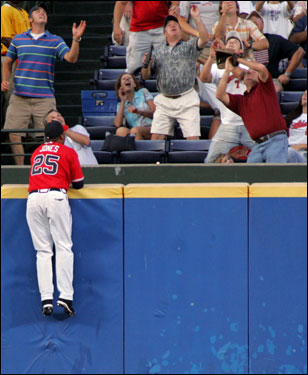 Braves center fielder Andruw Jones climbed the wall but was nowhere near the home run ball off the bat of David Ortiz in the first inning.