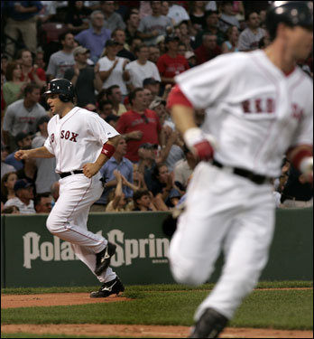 Doug Mirabelli (left) headed home on a bases-loaded single by Mark Loretta (right) in the second inning.