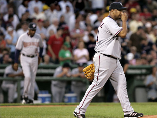 Livan Hernandez reacted after allowing six Red Sox hitters to score in the second inning.