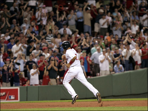 Coco Crisp rounded the bases as the crowd cheered his leadoff home run in the seventh inning. It was his first homer at Fenway as a member of the Red Sox.