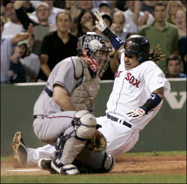 Manny Ramirez beat the throw home to score on a Trot Nixon double, along with David Ortiz (not pictured) in the sixth.