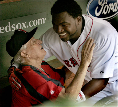 Sox legend Johnny Pesky gave Ortiz in the dugout following Big Papi's second-inning grand slam.