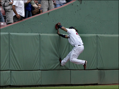 Manny Ramirez climbed the wall in left field to make a catch on a fly ball.
