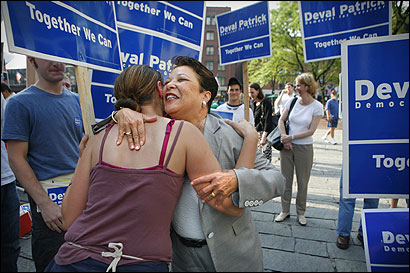 Diane Patrick (right), wife of the gubernatorial candidate, greeted a volunteer Thursday at Faneuil Hall.
