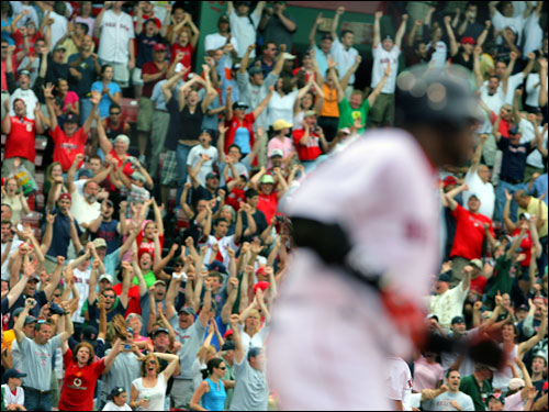 The crowd was in a frenzy as David Ortiz (right) rounded first base after his heroic hit 12th inning hit.