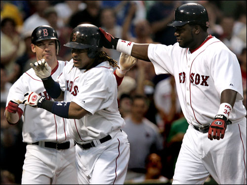 Manny Ramirez hit two home runs and drove in five as the Red Sox offense overpowered Philadelphia.