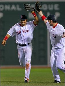 Coco Crisp is congratulated by Trot Nixon following his acrobatic catch.