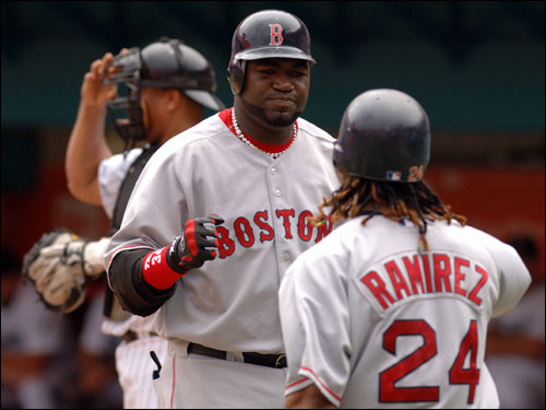 David Ortiz was congratulated by Manny Ramirez after Ortiz's third inning home run.