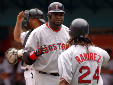 David Ortiz celebrates with Manny Ram&#237;rez after hitting his third home run in two games.