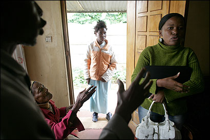 Social worker Neria Ledwaba (right), at a home in Pretoria to counsel rape victim Petunia Nkele Laka (center), who is HIV-positive, found herself in the middle of a family argument.