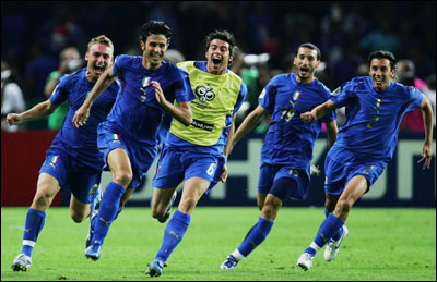 His clinching penalty kick having given Italy a second wind at the conclusion of a marathon World Cup final, Fabio Grosso (second from left) leads his jubilant teammates on a celebratory sprint.