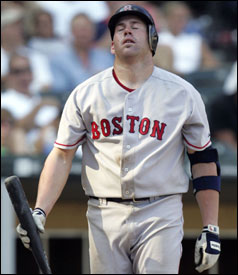 A frustrated Kevin Youkilis heads back to the dugout after striking out in the 13th inning. Youkilis finished 0 for 5.
