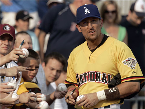 National League write-in selection Nomar Garciaparra signed autographs prior to the start of the Home Run Derby.