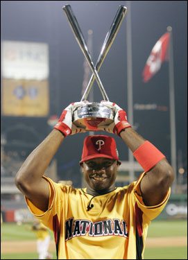 Ryan Howard posed with the trophy after winning the 2006 Home Run Derby. Howard is the second straight Philadelphia player to win the award after Bobby Abreu took it home in 2005.