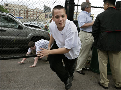 Josh Earle, 16, of Roslindale snuck into the June 28 Red Sox-Mets game at Fenway Park (Pedro Martinez's return to the Fenway mound) by going under the fence on Van Ness Street and into Fenway through RemDawg's on Yawkey Way. Behind him is Sean Driscoll, 16, of Hyde Park.