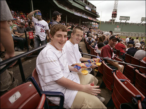 Driscoll and Earle picked out choice box seats after sneaking into Fenway Park to see Pedro Martinez in his return to Boston.