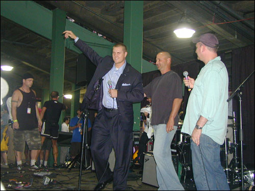 Then came a big suprise, when Jonathan Papelbon took the stage to help auction off a massive package of Boston sports items.
