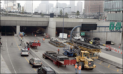 Work continued yesterday inside and outside the I-90 connector tunnel, which will remain closed until inspectors are certain of its safety.