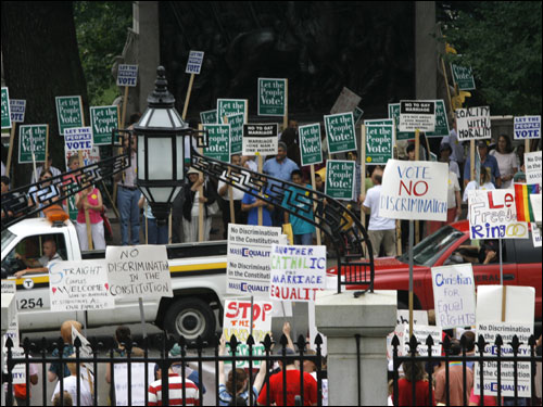 Supporters and opponents of Gay Marriage lined up on opposite sides of Beacon Street in front of the State House Wednesday.