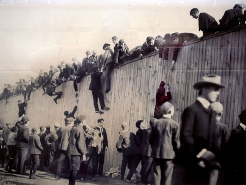 It's a practice that goes way back: Fans were hoisted up the fence and into the Huntington Grounds, Fenway Park's predecessor, during the 1903 World Series. (Photo Courtesy McGreevy Collection, Boston Public Library)