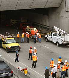 Officials and crews worked at the scene of the accident at the Mass. Pike connector tunnel on Tuesday, July 11.