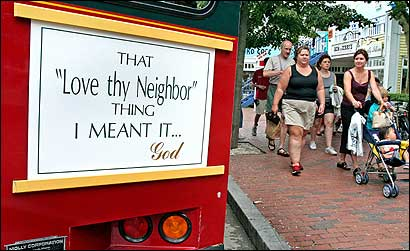 The operator of a Provincetown trolley said the sign on her vehicle summed up her feelings on the recent tensions.