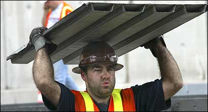 An ironworker, who would not give his name, carried a section of tunnel ceiling yesterday that was being removed.