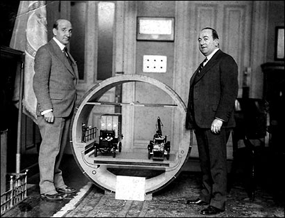 Colonel Thomas Sullivan (left) and City Treasurer Edward L. Dolan with a model of the Sumner tunnel, then under construction.